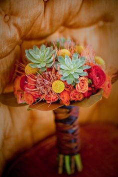 My work; assortments of oranges, reds and yellows with succulents.