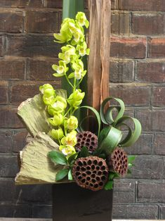 Wonderful Special event piece, green orchids, lotus pods, stunning. Thanks to: Everyday Floral | Abby's Floral Designs