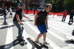 The NYPD redirects skateboarders from riding down Broadway in their annual