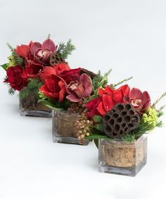 Joyous Trio - A fun and festive grouping of seasonal tones and textures are gathered in birch lined cube vases. These arrangements are the perfect breakaway style centerpiece to trail down your table or can be placed throughout the room.