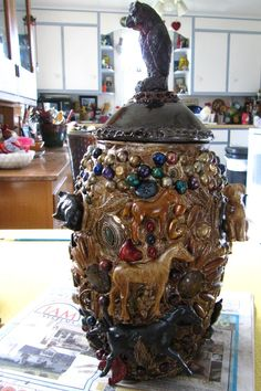 memory jug i made to honor my mom.  titled: watching over marion,by joyce champeau...via Terry Matlen