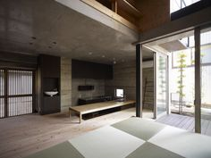asian home with sunken kitchen so they sit on the floor instead of bar stools.