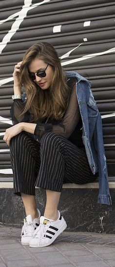 Pinstripe Trousers With A Denim Jacket: Silvia Garcia is wearing a pair of black pinstripe pants from Zara... | Style Inspiration
