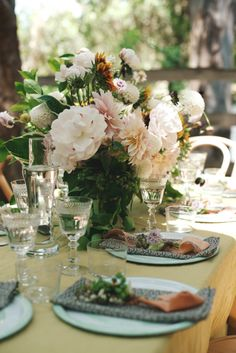 To set the table, I used Variopinte enamel plates and bowls in white and mint, which just came in at my Montecito Home store, and my favorite mismatched antique flatware   tables settings    how to host the perfect garden party   Jenni Kayne x @eyeswoon    Rip Plus Tan   Eye Swoon   summer entertaining guide