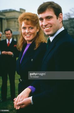 Prince Andrew with Sarah Ferguson at Buckingham Palace after the announcement of their engagement, London, 17th March 1986. Ferguson's white and yellow gold engagement ring features a Burma ruby, surrounded by ten drop-diamonds.
