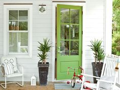 White cottage with apple green door, Sherwin Williams Organic Green