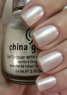 White Shimmer: Two to three coats of a shimmery white polish looks amazing for all your wintertime 'fits, the color goes with everything and the shimmer lends a touch of glam