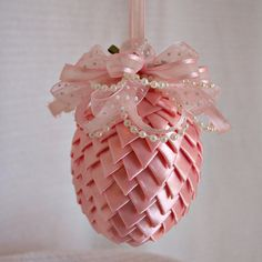 """Easter Egg Decoration...5 yes of 5/8"""" ribbon, cut and folded into triangles then attached to Styrofoam w straight pins."""