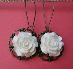 GASP!! LOVE THESE!...WHITE ROSE earrings on French wires. $7.00.  So pretty.  http://www.etsy.com/listing/122121985/white-rose?#
