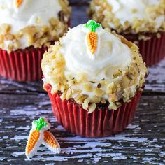 A recipe for Carrot Cake Cupcakes. These perfectly moist and fabulously flavorful cupcakes are packed with freshly grated carrot and sweet pineapple. Topped with fluffy, vanilla cream cheese frosting