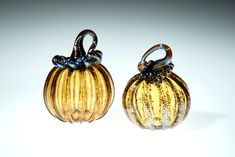 Amber Glass Pumpkin with Brown Stem, This piece is one of our smaller pumpkins, they range in size from 3-4 inches. Some of the pumpkins we roll through a little frit on the surface, frit is small chips of glass that give the piece a little extra sparkle. You can see this in the detail photo number 4. This is a great fall wedding gift, Fall decor, gift for mom, gift for a friend, gift for dad, fall wedding gift, anniversary gift, or just a nice little pumpkin to add to your collection. Small Pumpkins, Glass Pumpkins, Fall Wedding, Wedding Gifts, Corning Museum Of Glass, Fall Gifts, Amber Glass, Thanksgiving Decorations, Gifts For Dad