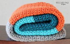 This simple single crochet color blocked blanket is the perfect beginner crochet project tutorial to tackle. Learn how to make this easy blanket with my free crochet tutorial. I recently finished a crochet Three Striped Blanket for my living room couch and still being inspired I attempted to make something similar for son Sam's bedroom. This simple beginner blanket works up so fast and uses only single crochets throughout! COLOR