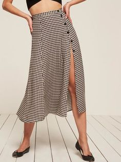 Looks great with a gust of wind. This is a midi length skirt with side button detail and a high slit. This style comes in petite sizes.