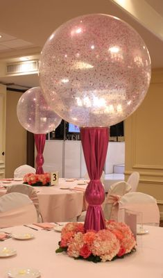 Sweet 16 centerpiece with feathers