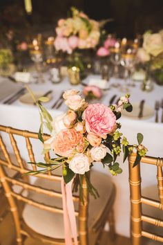 Wedding chairs decorated with pale pink and peach flowers| Photography by http://www.jacksonandcophotography.com/