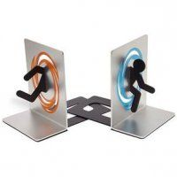 "PORTAL BOOKENDS    -Bookends for test subjects at Aperture Science  -Left side features half of a test subject going through an orange portal  -Right side features the other half of the test subject coming out the blue portal  -Officially licensed Portal collectible  -Made of shiny & durable aluminum, non-slip rubber padding on bottom  -Dimensions: 4"" x 5"" x 2.25"" each"
