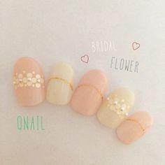 これからの季節にぴったり♡ふんわり可愛い春色ブライダルネイルまとめ*にて紹介している画像