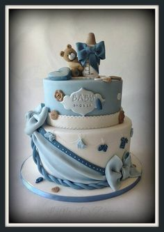 Teddy with the bottle :)  - Made this cake for a friends baby shower :) .enjoyed every bit of making this cake :)