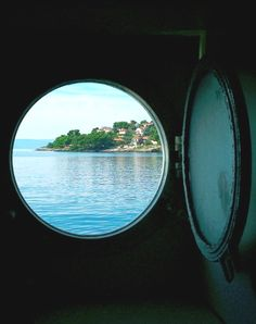 Ship porthole... Get one for your home: http://www.completely-coastal.com/2012/08/porthole-windows-for-your-home-door-for.html