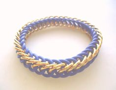Proud of your Airman and want the world to know it?  These military memorial bracelets are a great way to show support for a friend / relative / spouse in the USAF (United States Air Force), and are made with gold anodized aluminum paired with blue rubber connectors (for some stretch), in a simple but versatile half Persian 4-in-1 chainmail weave. As a bonus, I donate 5% of the proceeds from each sale, to the Tragedy Assistance Program for Survivors (TAPS) charity.  Aim High :)