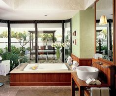 Garden Bath - The ceiling faucet over the Kohler tub has the effect of a rain shower.