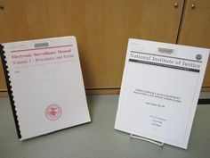 The July book display features government documents on surveillance