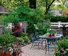Plantings frame a beautiful brick patio!