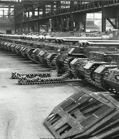 "German ""Elefant"" Tank Destroyers on the assembly line. These were a Schwerer Panzerjäger, or ""heavy tank-hunter,"" of the Wermacht during World War II. Built in small numbers beginning in 1943 under the name ""Ferdinand"" after its designer, Ferdinand Porsche, it was built on the same hull that had been used for the Tiger I tank requirement, but were rejected in favor of the competing Henschel design. ~~~~~~~~~~~~~~~~~~~~~~~~~~~~~~~~~~~Follow to become a fellow comrade! #ww2 #wwii #worldwar2…"