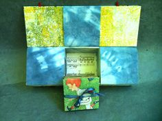 """an opposing-hinge box, holding """"Dreaming of Running the Bases"""" by Kathy Carver Steinsberger"""