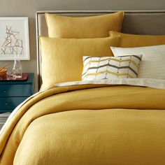 I love this mustard and khaki! I feel a bedroom update coming on… (image is from West Elm).