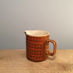 "Vintage Hornsea ""Saffron"" Gravy Jug  £8.50 Hornsea was wildly popular in the 70's and was produced until the early 90's.  This saffron gravy jug is the perfect retro vibe for your home!  Dimensions  Height 7.5cm, Diameter 10cm."