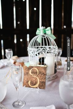 gold table numbers and bird cage centerpieces | CHECK OUT MORE IDEAS AT WEDDINGPINS.NET | #wedding