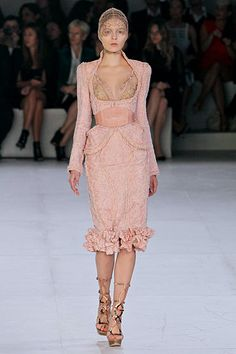 Alexander McQueen- 2012. I don't get the webby headgear, but the cut and textures are sublime