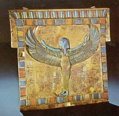 """Pectoral Featuring Nut Nut is shown here as a woman with vulture's wings outspread to symbolize her function as a protectress. It is a role that she is often represented as performing on the underside of the lids of coffins. All around her body are hieroglyphic inscriptions, of which there are three in all. At the top are the king's throne and personal names, separated by the title """"Lord of the Two Lands"""" followed by """"The Great and Glorious Nut,"""" and, beneath the wings of the goddess"""