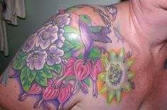 These are my tats on my left shoulder and partial back of my shoulder. Still very much a work in progress. All the flowers, I have grown in my own yard, so each tat really is special to me. Peace, B