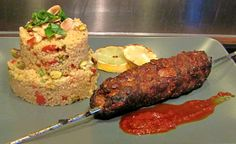 Pork skewers favoured with Fennel and Almonds, grilled on a skewer and serve with a Cous Cous salad with toasted pistachios, spicy peppers, lemon, mint & coriander served with a Harissa dressing.