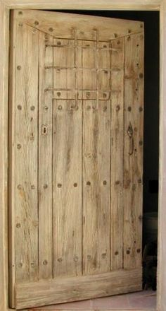 Portes Antiques french manufacturer, restoring and creation Rustic entrance door with bars Aged wood finish. Grey Front Doors, Window Handles, Rustic Luxe, Hacienda Style, Aging Wood, Rustic Doors, Entrance Gates, Old Doors, Door Knockers