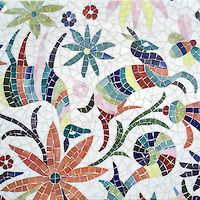 Otomi, a jewel glass mosaic, shown in Absolute White, Peridot, Aventurine, Lapis Lazuli, Sardonyx, Citrine, and Ruby, is part of the Kiddo Collection by Cean Irminger for New Ravenna.