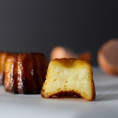 Caneles (Canelles) de Bordeaux    The size of small cupcakes, these custardy treats are flecked with vanilla and baked until the edges are deep amber in color. Not overly sweet, they're a lot like creme brulee, but in a grabbable, portable format.   Full recipe platingsandpairings.com
