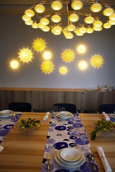 "dining room, finnish embassy in france, photo by oiva : ash wood table by nikari / ""dahlia"" sconces and chandelier, by janne kyttänen / ""sunnuntai"" table runners by matti pikkujämsä x kauniste / tableware by iittala Wood Table, Dahlia, Table Runners, Sconces, Dining Room, Chandelier, Ceiling Lights, France, Paris"