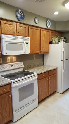 Best Granite Color To Tie Together Oak Cabinets With White Appliances Blanco Tulum Granite