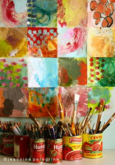 This is a picture found on Four Rooms Blog. I just love the bright look. The art and most of all the cans used for brushes!! Awesome