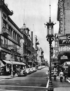 A lampost in the traditional Chinese style signals that you've arrived.  San Francisco circa 1950.