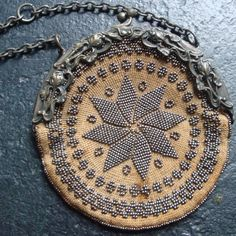 Civil War Beaded Bag, Antique Americana Leather Purse, Coin Purse, Steel Beads, Wrist Chain, Silver Frame..Circa 1900. $175.00, via Etsy.