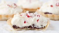 These personal-sized white chocolate and peppermint mini tarts are an elegant dessert worthy of any holiday gathering.
