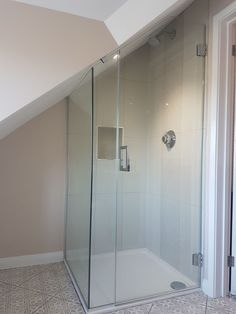 Frameless attic shower enclosure installed in Kent. Frameless attic shower enclosure installed in Kent. Attic Shower, Small Attic Bathroom, Loft Bathroom, Upstairs Bathrooms, Bathroom Interior, Diy Bathroom, Bathroom Renovation Cost, Attic Renovation, Attic Remodel