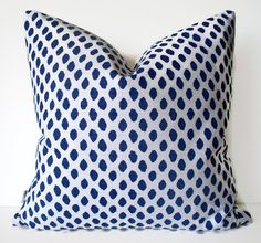Indigo Blue Dots Pillow Cover Lacefield Sahara Midnight Ikat Dot Pillow Cover Another gorgeous pillow cover! Blue and white ikat design. Textured bark cloth like fabric. BOTH SIDES option.      Coordinate shown: https://www.etsy.com/listing/197407617/navy-check-pillow-cover-blue-indigo?ref=shop_home_active_5     [FABRIC CONTENT] Cotton/rayon blend. Screen printed on textured cotton (similar to bark cloth) Medium/heavyweight   [COLOR(S)] Blue and white Reverse is a white cotton. ****Colors on…