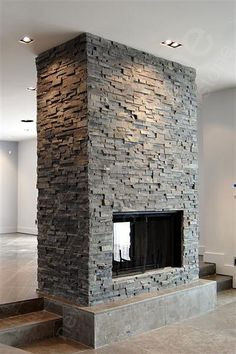 Slated double sided fireplace, i like the idea of double sided fireplaces well executed. this seems great except for the ceiling. It would be cool if the left was the house foyer