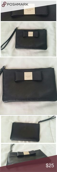 Kate Spade Bow Wristlet This cute, classy, and convenient KS wristlet is the perfect accessory! Throw it into a handbag, or use it by itself on a special night out. Either way, it's bound to become a favorite! Exterior features black leather with bow detail and gold tone hardware, and interior features black, signature fabric (no pockets). In excellent condition! kate spade Bags Clutches & Wristlets
