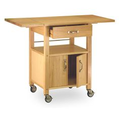 Features:  -Utility drawer.  -Lower shelf and storage cabinet.  -4 Casters (2…